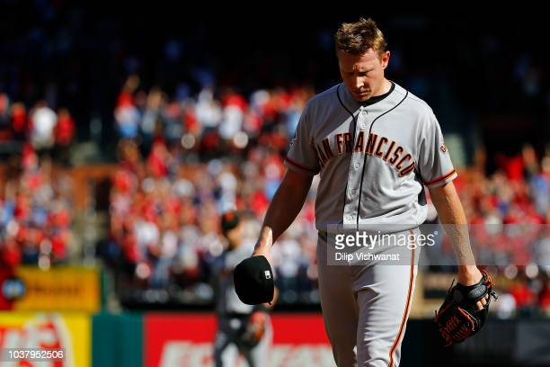 Mark Melancon of the San Francisco Giants leaves the field after giving up the gamewinning home run against the St Louis Cardinals in the tenth...