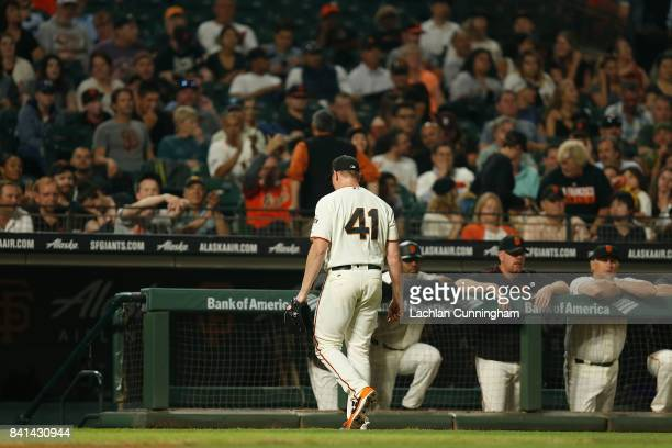 Mark Melancon of the San Francisco Giants walks to the dugout after being replaced in the eighth inning of the game against the St Louis Cardinals at...