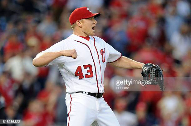 Mark Melancon of the Washington Nationals celebrates after a victory against the Miami Marlins at Nationals Park on October 2 2016 in Washington DC