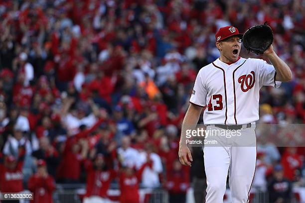 Mark Melancon of the Washington Nationals celebrates after the Washington Nationals defeated the Los Angeles Dodgers 52 in game two of the National...