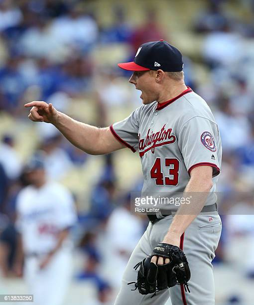 Mark Melancon of the Washington Nationals celebrates in the ninth inning of Game 3 of NLDS against the Los Angeles Dodgers at Dodger Stadium on...