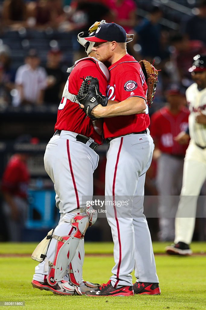 Mark Melancon #43 (right) of the Washington Nationals celebrates with teammate Wilson Ramos after defeating the Washington Nationals 11-9 at Turner Field on August 20, 2016 in Atlanta, Georgia.