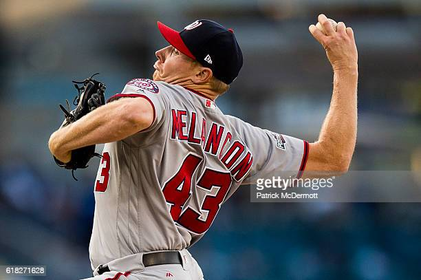 Mark Melancon of the Washington Nationals throws a pitch to a Los Angeles Dodgers batter during the ninth inning in game three of the National League...