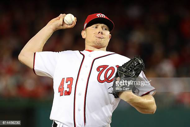 Mark Melancon of the Washington Nationals works against the Los Angeles Dodgers in the eighth inning during game five of the National League Division...