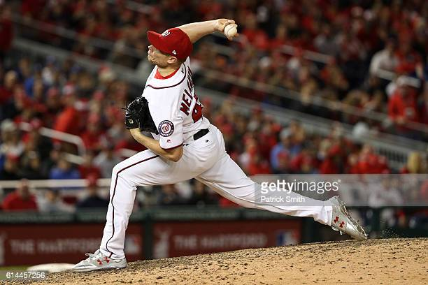 Mark Melancon of the Washington Nationals works against the Los Angeles Dodgers in the ninth inning during game five of the National League Division...