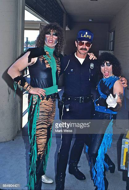 Mark Mendoza and AJ Pero of Twisted Sister with LAPD police officer on the set of the video shoot for their single 'I Wanna Rock' Los Angeles...
