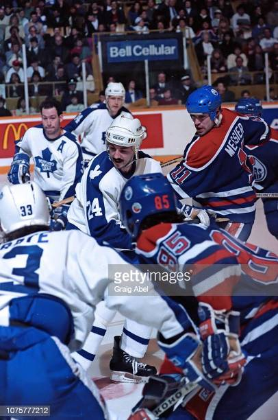 Mark Messier and Petr Klima of the the Edmonton Oilers skate against Dan Daoust Al Iafrate Brad Marsh and Dave Reid of the Toronto Maple Leafs during...