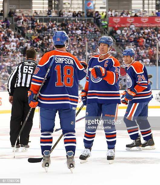 Mark Messier celebrates with Craig Simpson of the Edmonton Oilers alumni after scoring a goal on Winnipeg Jets alumni during the 2016 Tim Hortons NHL...
