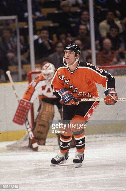 Mark Messier of the Campbell Conference and the Edmonton Oilers skates in front of goalie Glenn 'Chico' Resch of the Wales Conference and the New...