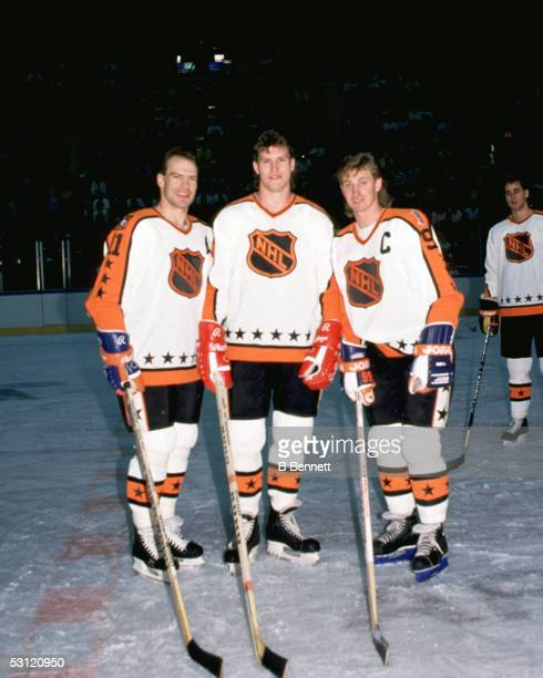Mark Messier of the Campbell Conference and the Edmonton Oilers poses for a portrait with teammates Bob Probert of the Detroit Red Wings and Wayne...