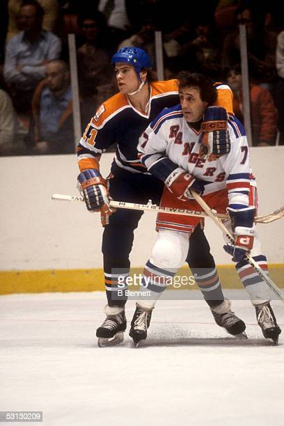 Mark Messier of the Edmonton Oilers battles with Phil Esposito of the New York Rangers on October 24 1979 at the Madison Square Garden in New York...