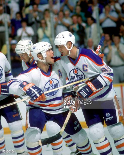 Mark Messier of the Edmonton Oilers celebrates with his teammate Wayne Gretzky during the 1988 Stanley Cup Finals against the Boston Bruins in May...