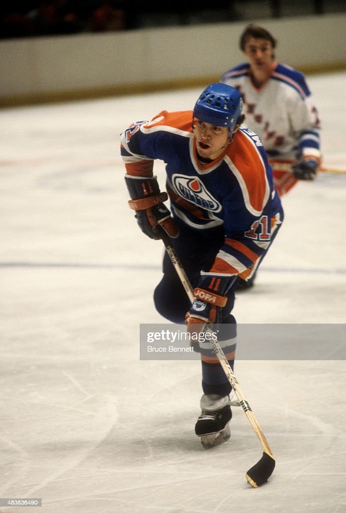 Mark Messier #11 of the Edmonton Oilers looks to shoot during an NHL game against the New York Rangers on November 14, 1982 at the Madison Square Garden in New York, New York.