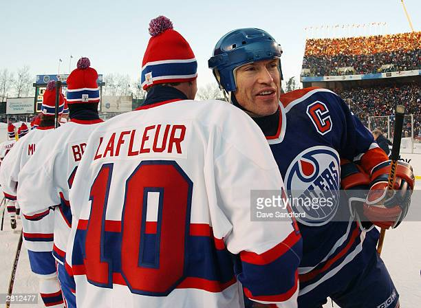 Mark Messier of the Edmonton Oilers shakes hands with Guy Lafleur of the Montreal Canadiens during the Molson Canadien Heritage Classic on November...