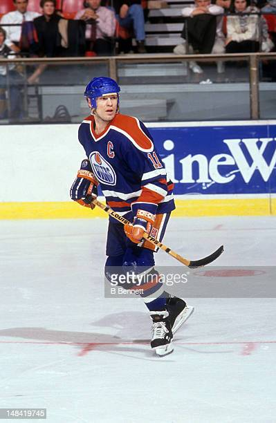 Mark Messier of the Edmonton Oilers skates on the ice during an NHL game circa 1990.
