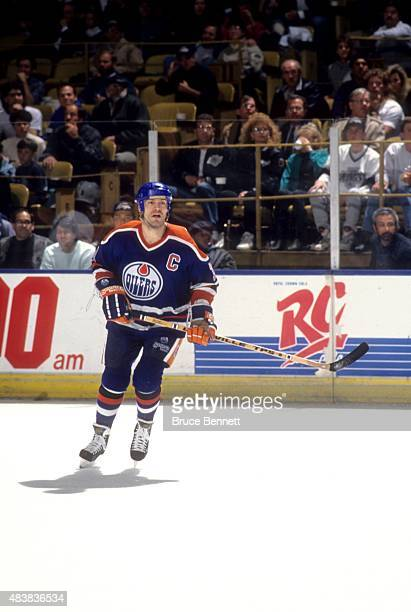 Mark Messier of the Edmonton Oilers skates on the ice during an NHL game against the Los Angeles Kings circa 1990 at the Great Western Forum in...