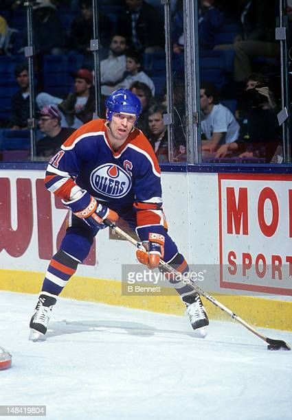 Mark Messier of the Edmonton Oilers skates with the puck during an NHL game against the New York Islanders on January 17 1991 at the Nassau Coliseum...