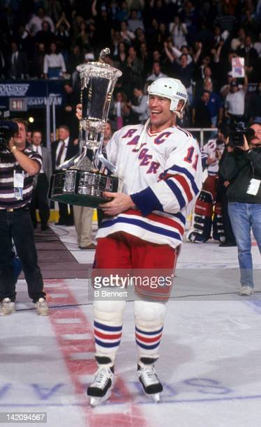 Mark Messier of the New York Rangers holds the Eastern Conference Championship Trophy after the Rangers defeated the New Jersey Devils in Game 7 of...