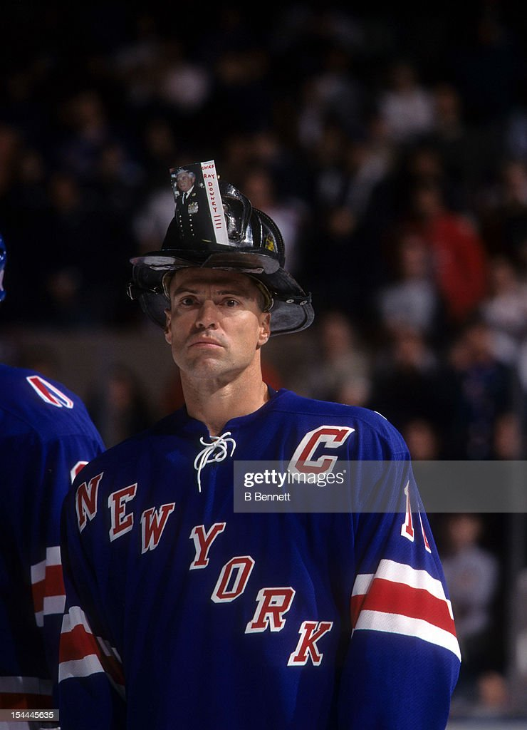 Mark Messier #11 of the New York Rangers wears an NYFD helmet to support the victims of the September 11 attacks on New York City on October 7, 2001 at the Madison Square Garden in New York, New York.
