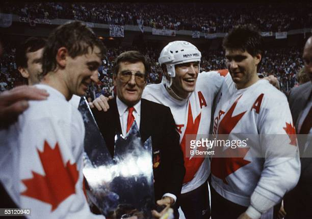 Mark Messier Ray Bourque and Wayne Gretzky of Canada recieve the Canada Cup Trophy from Alan Eagleson after defeating the Soviet Union in Game 3 of...