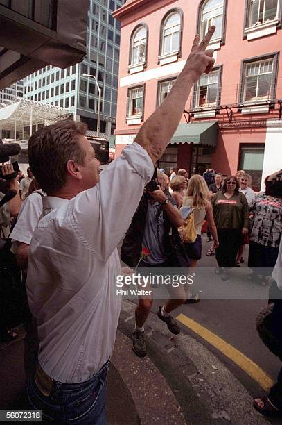 Mark Middleton gestures to supporters after he was given a 9 month suspended sentence in force for two years for treatening to kill Paul Daly