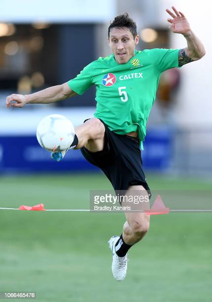 Mark Milligan kicks the ball during a Socceroos training session at Lions FC Stadium on November 12 2018 in Brisbane Australia