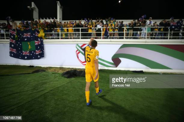 Mark Milligan of Australia acknowledges the fans following his sides victory after a penalty shootout in the AFC Asian Cup round of 16 match between...
