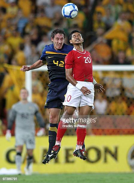 Mark Milligan of Australia and Bambang Pamungkas of Indonesia compete for the ball during the Asian Cup Group B qualifying match between the...