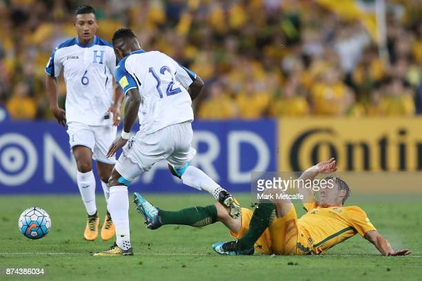 Mark Milligan of Australia and Romell Quioto of Honduras compete for the ball during the 2018 FIFA World Cup Qualifiers Leg 2 match between the...