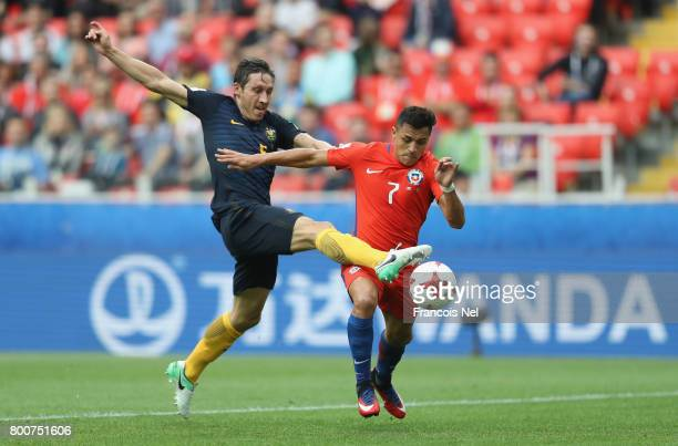 Mark Milligan of Australia attempts to stop Alexis Sanchez of Chile from scoring during the FIFA Confederations Cup Russia 2017 Group B match between...