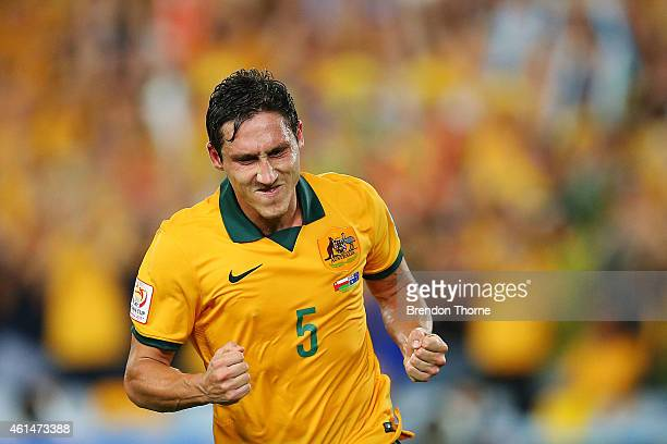Mark Milligan of Australia celebrates after scoring a goal during the 2015 Asian Cup match between Oman and Australia at ANZ Stadium on January 13...