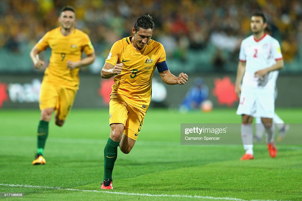 Mark Milligan of Australia celebrates kicking a penalty goal during the 2018 FIFA World Cup Qualification match between the Australia Socceroos and Tajikistan at the Adelaide Oval on March 24, 2016 in Adelaide, Australia.