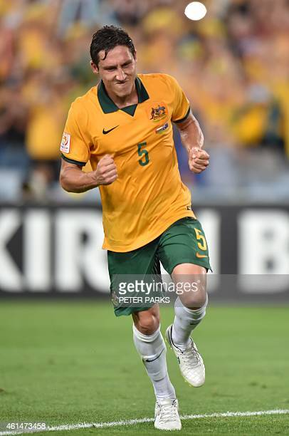 Mark Milligan of Australia celebrates scoring a penalty against Oman during their Group A football match at the AFC Asian Cup in Sydney on January...