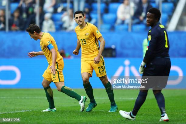 Mark Milligan of Australia celebrates scoring his sides first goal with Tommy Rogic of Australia as Joseph Ondoa of Cameroon reacts during the FIFA...