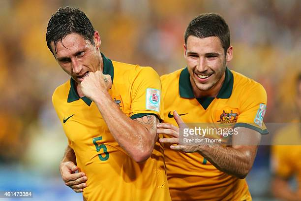 Mark Milligan of Australia celebrates with team mate Mathew Leckie after scoring a goal during the 2015 Asian Cup match between Oman and Australia at...
