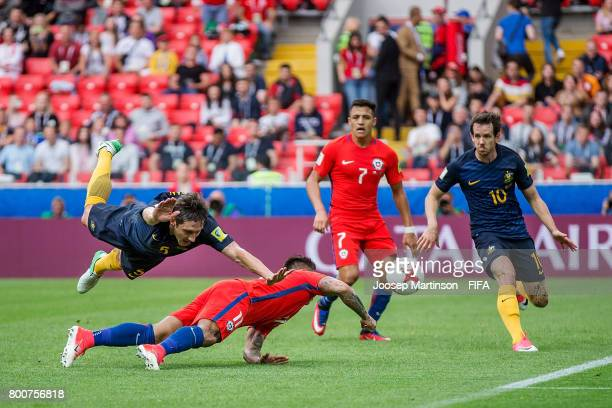 Mark Milligan of Australia clashes with Eduardo Vargas of Chile during the FIFA Confederations Cup Russia 2017 group B football match between Chile...
