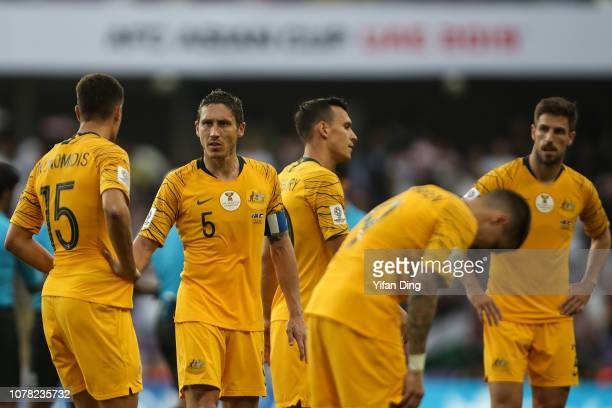 Mark Milligan of Australia comforts teammates after losing the AFC Asian Cup Group B match between Australia and Jordan at Hazza Bin Zayed Stadium on...