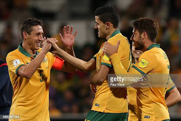 Mark Milligan of Australia congratulates Tom Rogic after scoring a goal during the 2018 FIFA World Cup Qualification match between the Australian...