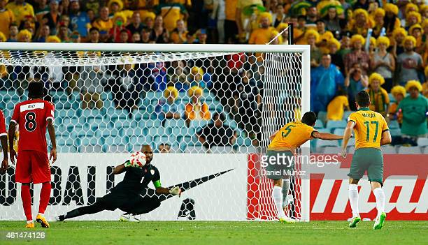 Mark Milligan of Australia scores a penalty kick during the 2015 Asian Cup match between Oman and Australia at ANZ Stadium on January 13 2015 in...
