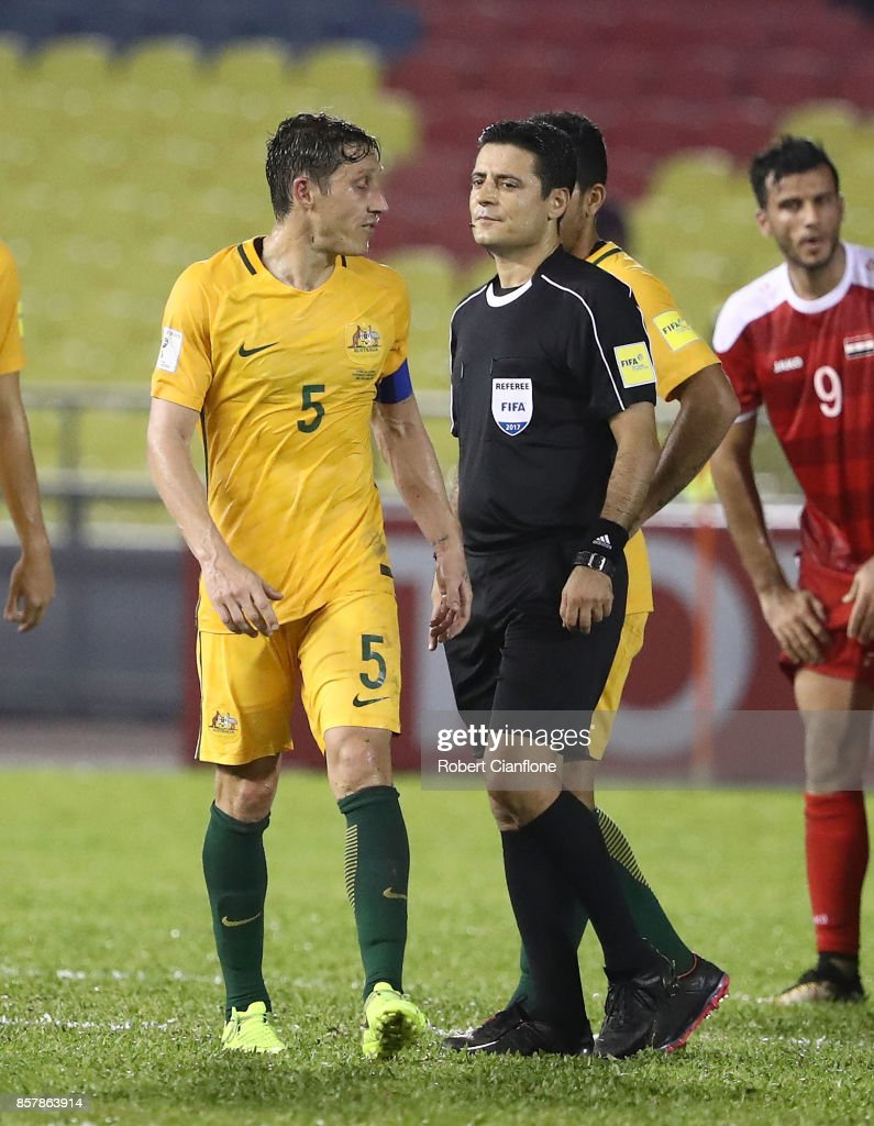 Mark Milligan of Australia speaks to referee Alireza Faghani after the 2018 FIFA World Cup Asian Playoff match between Syria and the Australia Socceroos at Hang Jebat Stadium on October 5, 2017 in Malacca, Malaysia.