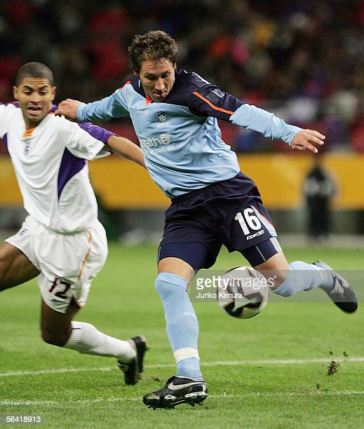 Mark Milligan of Sydney FC and Alvaro Saborio of Deportivo battle for the ball during the FIFA Club World Championship Toyota Cup 2005 match between...