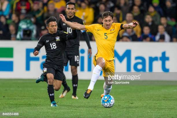 Mark Milligan of the Australian National Football Team and Chanathip Songkrasin of the Thailand National Football Team contest the ball during the...