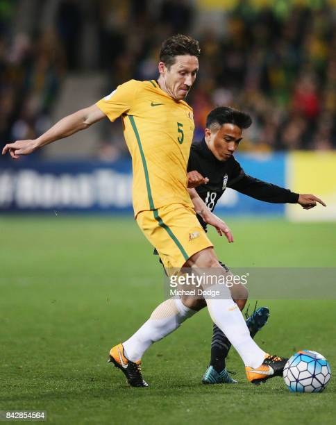 Mark Milligan of the Socceroos and Chanathip Songkrasin of Thailand compete for the ball during the 2018 FIFA World Cup Qualifier match between the...