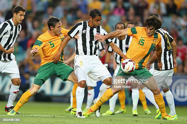 Mark Milligan of the Socceroos, Giancarlo Gonalez of Costa Rica and Mile Jedinak of the Socceroos compete for the ball in front of goal goal during...