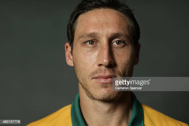 Mark Milligan of the Socceroos poses during an Australian Socceroos portrait session at Crowne Plaza Terrigal on May 20 2014 in Sydney Australia