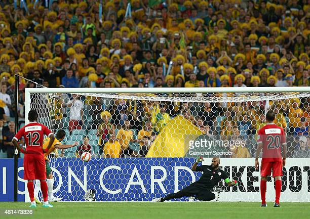 Mark Milligan of the Socceroos scores a penalty goal during the 2015 Asian Cup match between Oman and Australia at ANZ Stadium on January 13 2015 in...