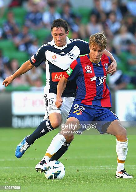 Mark Milligan of the Victory and Adam Taggart of the Jets contest for the ball during the round 23 ALeague match between the Melbourne Victory and...