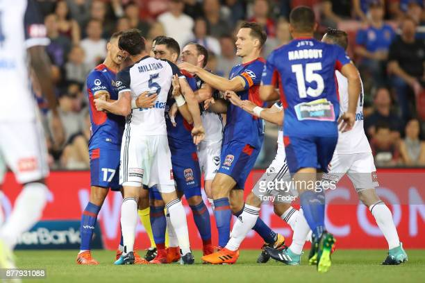 Mark Milligan of the Victory and Daniel Georgievski of the Jets clash during a heated exchange during the round eight ALeague match between the...