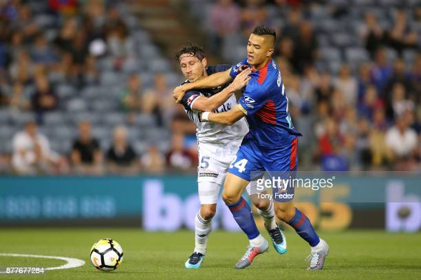 Mark Milligan of the Victory and Joseph Champness of the jets contest the ball during the round eight ALeague match between the Newcastle Jets and...