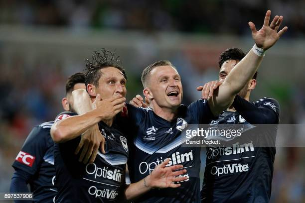 Mark Milligan of the Victory celebrates after kicking a goal with Besart Berisha of the Victory during the round 12 ALeague match between Melbourne...